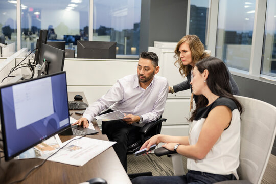 Business people meeting at laptop on office desk
