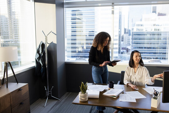 Businesswomen meeting and planning in highrise office