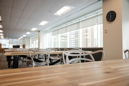 Empty open plan coworking space with table and chairs
