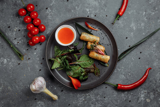 Spring rolls with shrimp with sweet chili sauce. Asian cuisine