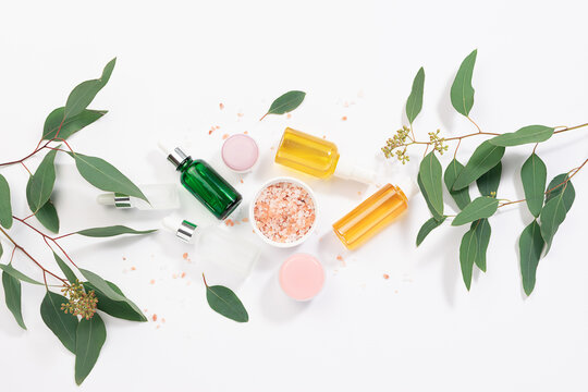Set of natural skin care products for spa, massage and wellness on white background with eucalyptus twigs.  Beauty blog social media banner.