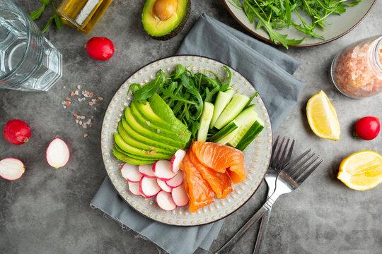 Smoked or salted salmon salad with avocado, arugula and radishes, eafood salad. Healthy food.