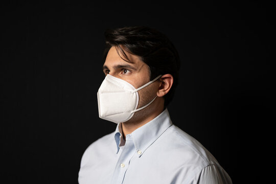 Latin man latino businessman wearing n95 mask for covid