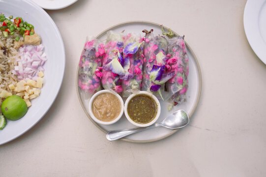 Beautiful and delicious Thai cuisine. Colorful appitizers made from edible flower or THAI NAME ( Miang Dok Mai )