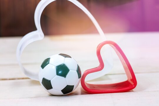 Soccer ball on Valentine's Day with red heart shape