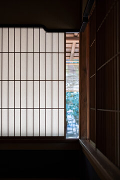 Washi paper used as Japanese shōji screen window on a Kōshi wooden lattice frame.