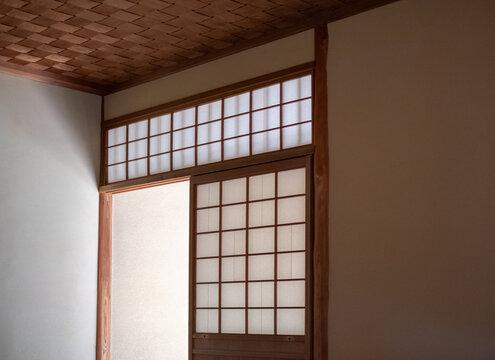 Washi paper used as Japanese shōji screen door on a Kōshi wooden lattice frame.