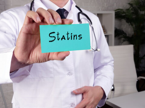 Health care concept meaning Statins with sign on the piece of paper.