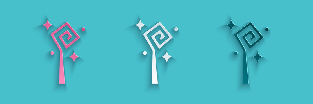 Paper cut Magic staff icon isolated on blue background. Magic wand, scepter, stick, rod. Paper art style. Vector.