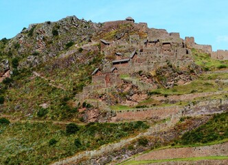 Peru Pisac ruins of Inca ancient fortress in Andes mountains. Citadel which served as a line of defense, and also  place of worship and in important agricultural site in Sacred valley. Wall mural