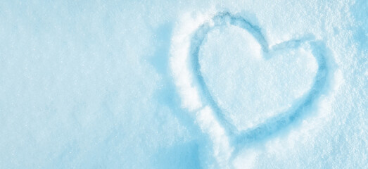 heart drawn on the snow in the park. Valentine's Day, winter vacation in the city