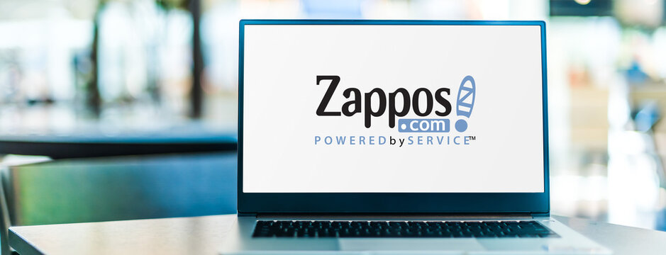 Laptop computer displaying logo of Zappos.com