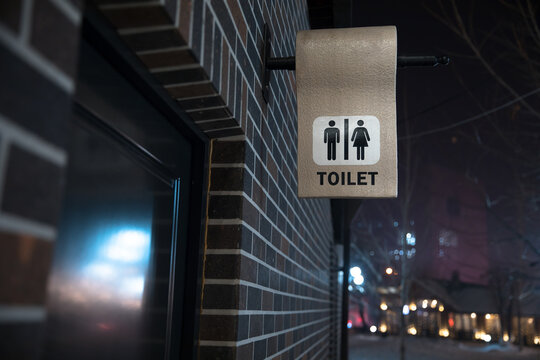 toilet sign in building wall