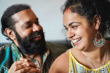 Indian couple having tender moments together indoors at home - Focus on woman face