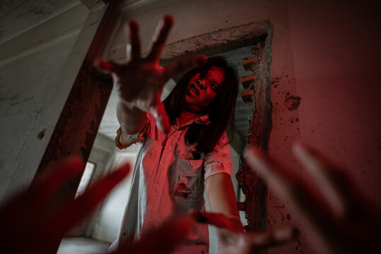 Zombies are chasing people in an abandoned building on Halloween.