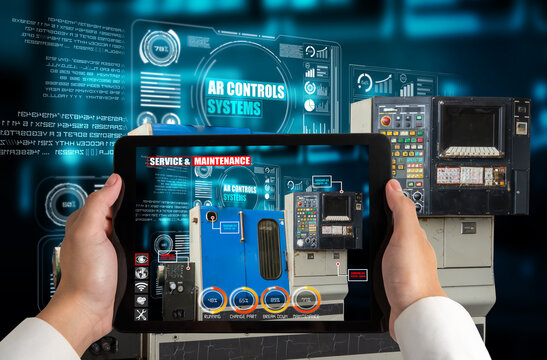 Engineer use augmented reality software in smart factory production line with automated application . Futuristic machinery in working in concept of Industry 4.0 or 4th industrial revolution.
