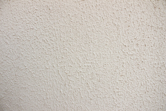 Cream color wall with rough texture