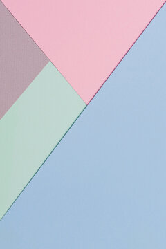 Abstract colored paper background. Minimal geometric shapes and lines in blue, light green, pastel pink, gray colours