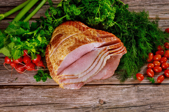 Hickory smoked spiral sliced ham with fresh vegetables.