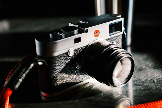 Bangkok, Thailand - Jan 6, 2021: Leica M10 full-frame digital rangefinder camera with Leica 50mm f2 Summicron M-mount lens. Vintage collectible classic camera concept. Illustrative editorial content