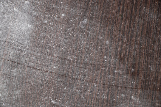 scattered chalk on a wooden table as background