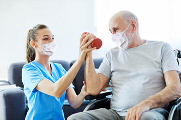 nurse doctor senior care exercise physical therapy mask virus help assistence retirement  man...