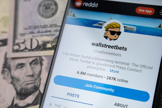 Wallstreetbets Reddit community web page seen on the smartphone screen and US dollars on a blurred background. Concept. Stafford, United Kingdom - January 30 2021.