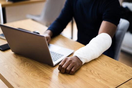 Injured Worker Compensation. Broken Arm African Man