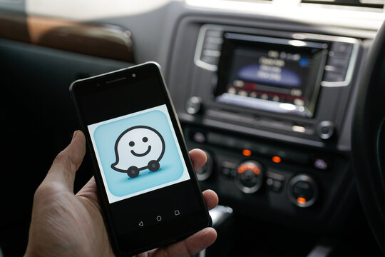 KUALA LUMPUR, MALAYSIA - January 30TH, 2021: modern lifestyle with smartphone to stay connected and browsing favourite Apps. Find your way point of interest with WAZE navigation apps
