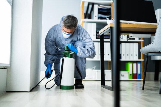 Pest Control Exterminator Man Spraying Pesticide