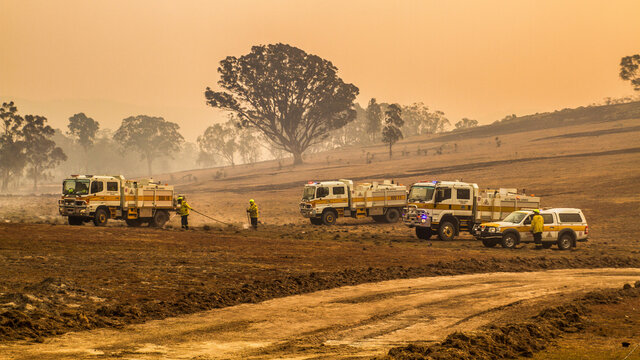 Firetrucks and Firefighters at a grassfire in Australia