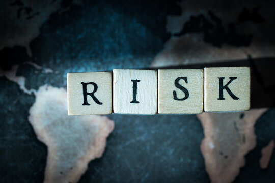 """Wooden cube block showing """"RISK"""" wording"""