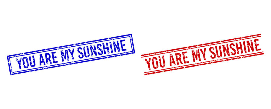 YOU ARE MY SUNSHINE rubber overlays with grunge texture. Vectors designed with double lines, in blue and red colors. Text placed inside double rectangle frame and parallel lines.