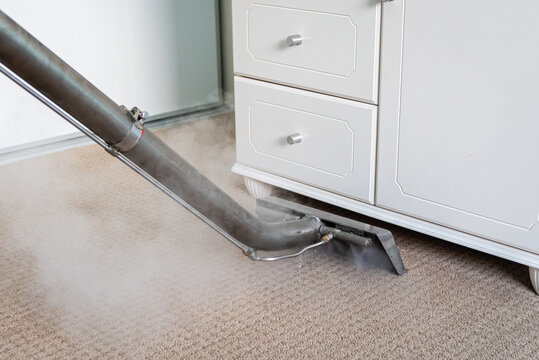 Steam Carpet Cleaning Of Carpets In A Bedroom - professional carpet cleaning