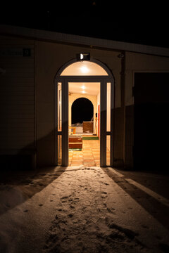 Entrance to a private rural house in the winter in the evening.