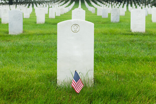 Headstones and Ameican flag in Arlington National Cemetery -Circa Washington D.C. United States of America