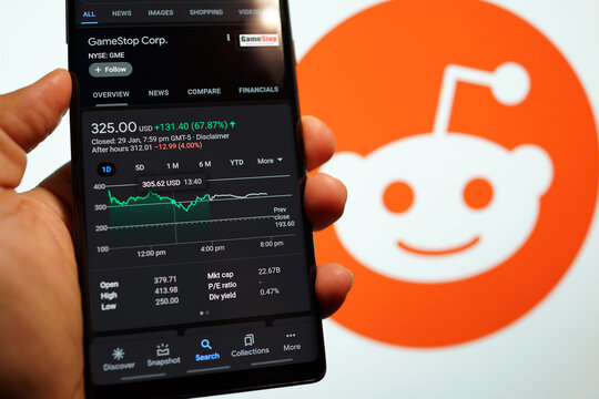 GameStop Corp stock index is seen on a smartphone. GameStop's stock soars as small traders from a Reddit group team up against big institutions. PENANG, MALAYSIA - 31 JAN 2021.