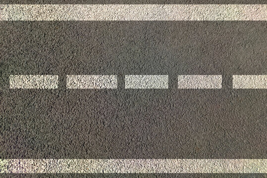 Road marking for lane driving , highways painted in white and yellow lines both direction traffic movement control by use of sign and symbols of traffic