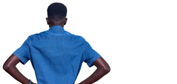 Young african american man wearing casual clothes standing backwards looking away with arms on body