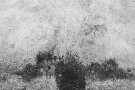 Old Wall for backgrounds. Old cement walls with black stains on the surface caused by moisture. Peeling wall surface with cracks and scratches, old rough gray cement wall surface for the background.