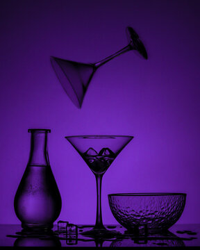 Closeup shot of glassware on a purple background