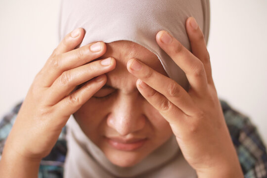 Sad depressed anxiety Asian muslim woman thinking contemplating bad thing happened in her life, stress exhausted feeling down expression, financial or relationship problem