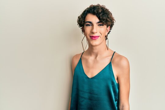 Young transgender man wearing make up and woman clothes, looking fashion and glamorous