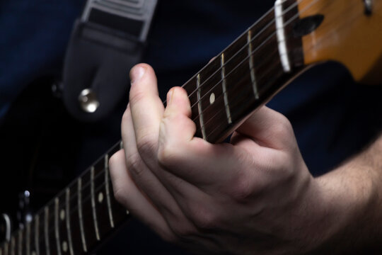 Musician's hand on guitar neck