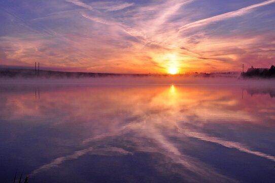 Misty beautiful sunrise over water