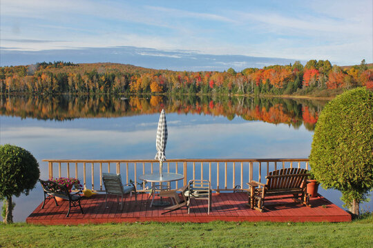Deck on a lake looking a fall colors