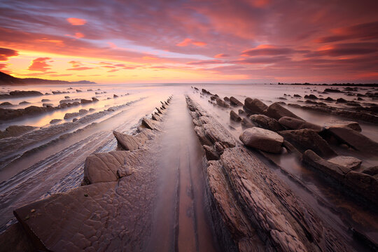 Gray rocky shore during sunset