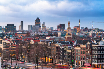 Amsterdam, Netherlands historic cityscape with the modern Zuidas district in the distance