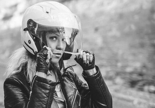 Black and white portrait of beautiful biker woman