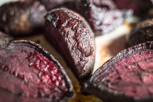 Roasted red beets on a baking tray